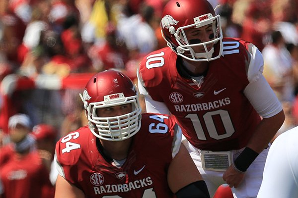 Arkansas' center Travis Swanson readies to hike the ball to quarterback Brandon Allen in their game with Louisiana-Lafayette at Reynolds Razorback Stadium in Fayetteville.