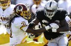 Oakland Raiders running back Darren McFadden (20) runs against Washington Redskins strong safety Brandon Meriweather (31) during the second quarter of an NFL football game in Oakland, Calif., Sunday, Sept. 29, 2013. (AP Photo/Ben Margot)