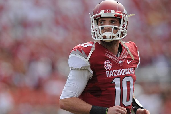 Arkansas quarterback Brandon Allen walks off the field after the Razorbacks failed to convert on third down during the second quarter of play Saturday, Oct. 12, 2013, at Razorback Stadium in Fayetteville.