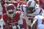 South Carolina defensive end Jadeveon Clowney runs down Arkansas running back Alex Collins during the third quarter of their game Saturday at Razorback Stadium in Fayetteville.