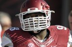 Arkansas defensive tackle Robert Thomas walks onto the field before an NCAA college football game against South Carolina in Fayetteville, Ark., Saturday, Oct. 12, 2013. (AP Photo/David Quinn)