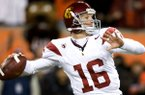 FILE - In this Saturday Nov. 20, 2010 file photo, USC Trojans quarterback Mitch Mustain, throws a pass during NCAA college football game against Oregon State in Corvallis, Ore. (AP Photo/Steve Dykes, File)