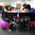 Kyra Guzman, 8,  left, sit with other classmates on yoga ball while Jack Salinas, 8, sits in a chair...