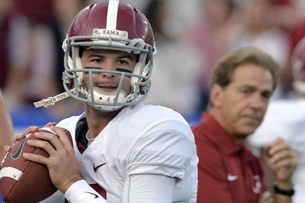 alabama-quarterback-aj-mccarron-warms-up-as-coach-nick-saban-watches-before-an-ncaa-college-football-game-against-kentucky-saturday-oct-12-2013-in-lexington-ky-ap-phototimothy-d-easley