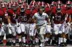 Alabama head coach Nick Saban leads the team out to start the second half of an NCAA college football game on Saturday, Oct. 5, 2013, in Tuscaloosa, Ala. (AP Photo/Butch Dill)
