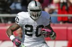 Oakland Raiders running back Darren McFadden (20) runs during the first half of an NFL football game against the Kansas City Chiefs at Arrowhead Stadium in Kansas City, Mo., Sunday, Oct. 13, 2013. (AP Photo/Ed Zurga)