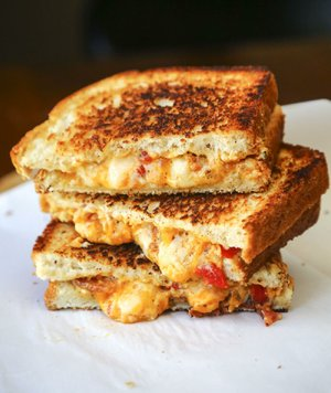 Southwest-style Grilled Pimento Cheese With Bacon combines creamy pimento cheese with zesty Southwestern seasoning and smoky bacon.