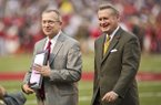 Arkansas Razorback athletic director Jeff Long, left, and chancellor Dave Gearhart walk off the field NCAA college football game against Texas A&M in Fayetteville, Ark., Saturday, Sept. 28, 2013. Long was accepting an award for athletic director of the year. (AP Photo/Beth Hall)