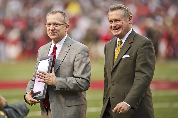 arkansas-razorback-athletic-director-jeff-long-left-and-chancellor-dave-gearhart-walk-off-the-field-ncaa-college-football-game-against-texas-am-in-fayetteville-ark-saturday-sept-28-2013-long-was-accepting-an-award-for-athletic-director-of-the-year-ap-photobeth-hall