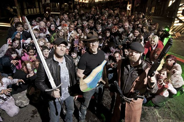 hosts-adam-savage-and-jamie-hyneman-center-and-right-are-joined-by-walking-dead-star-michael-rooker-and-about-100-undead-extras-in-a-special-mythbusters-zombie-episode-airing-at-9-pm-today-on-discovery