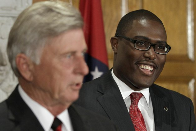 frank-scott-jr-right-smiles-as-arkansas-gov-mike-beebe-left-announces-scotts-appointment-to-the-arkansas-highway-commission-at-the-state-capitol-in-little-rock-ark-thursday-oct-17-2013