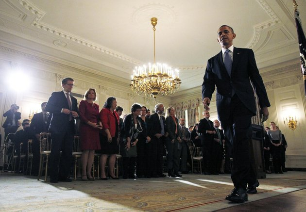 an-audience-comprising-of-white-house-staff-members-stands-as-president-barack-obama-leaves-the-state-dining-room-of-the-white-house-in-washington-on-thursday-oct-17-2013-after-he-made-a-statement