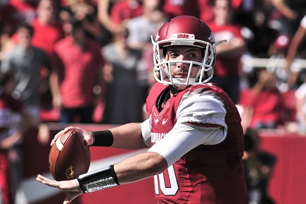 Arkansas quarterback Brandon Allen passes during the first half of an NCAA college football game against South Carolina in Fayetteville, Ark., Saturday, Oct. 12, 2013. (AP Photo/April L Brown)
