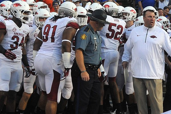 University of Arkansas coach Bret Bielema leads the Razorbacks onto the field before the start of a game at Ben Hill Griffin Stadium in Gainesville, Florida.