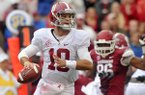Alabama quarterback A.J. McCarron looks to pass during a Sept. 15, 2012 game at Razorback Stadium in Fayetteville.