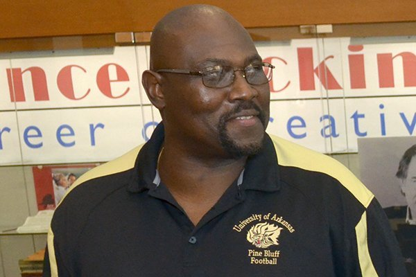 Former University of Arkansas football player Dennis Winston at the Washington County Historical Society in 2012. Winston and other former Razorbacks spoke about their experiences being among the first black players to play at the University of Arkansas.