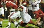 Arkansas defensive tackle Darius Philon (91) makes a tackle on Alabama running back T.J. Yeldon (4) Saturday at Bryant-Denny Stadium in Tuscaloosa, Alabama. Philon recorded eight tackles against the Crimson Tide.