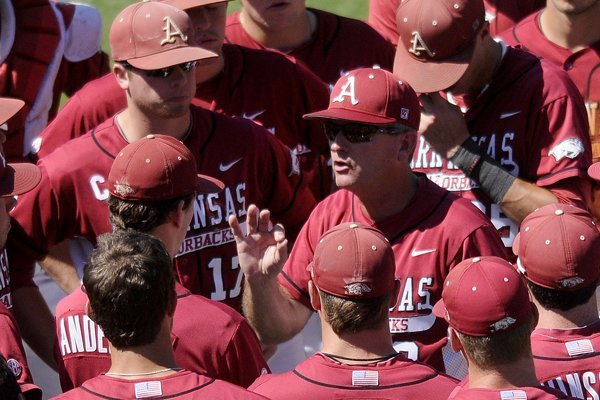 Arkansas coach Dave Van Horn talks to his players after a game against LSU.