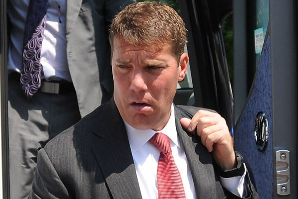 Arkansas defensive coordinator Chris Ash arrives at Razorback Stadium prior to an Aug. 31, 2013 game against Louisiana-Lafayette.