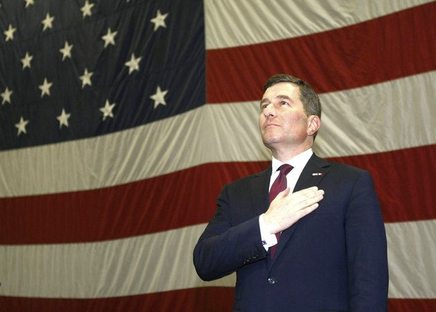 in-this-march-8-2013-file-photo-us-ambassador-to-france-charles-h-rivkin-stands-as-the-us-national-anthem-is-played-aboard-us-aircraft-carrier-uss-dwight-d-eisenhower-in-marseille-southern-france
