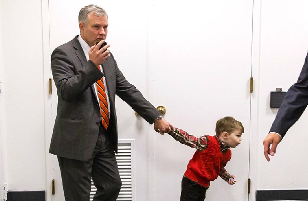 rep-tim-griffin-left-of-arkansas-is-tugged-along-by-his-son-john-as-he-and-other-republican-lawmakers-arrive-oct-8-on-capitol-hill-for-a-strategy-session
