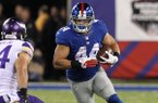 New York Giants' Peyton Hillis (44) rushes as Minnesota Vikings strong safety Andrew Sendejo (34) trails the play during the second half of an NFL football game Monday, Oct. 21, 2013 in East Rutherford, N.J. (AP Photo/Peter Morgan)