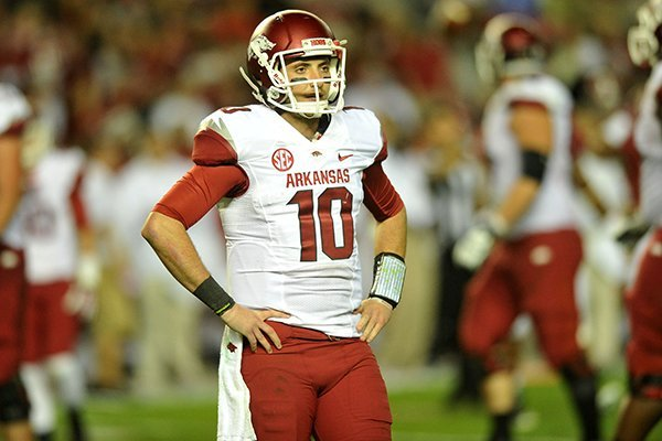 Arkansas quarterback Brandon Allen looks toward the sideline during the Razorbacks' 52-0 loss at Alabama on Saturday, Oct. 19, 2013.