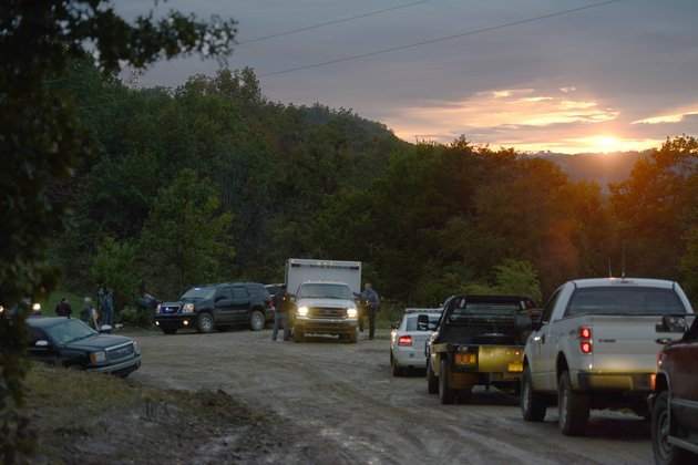first-responders-at-the-staging-area-at-the-intersection-of-madison-county-road-5320-and-5555-monday-oct-21-2013-for-a-search-for-a-plane-crash-in-rural-madison-county