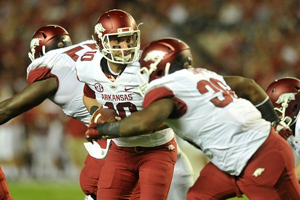 Arkansas quarterback Brandon Allen (10) runs a play during Saturday night's game at Bryant-Denny Stadium in Tuscaloosa, Ala.