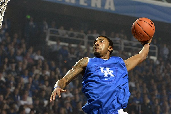 James Young goes up for a slam dunk during action of Kentucky's Big Blue Madness scrimmage Friday, Oct. 18, 2013 in Lexington, Ky.(AP Photo/Timothy D. Easley)