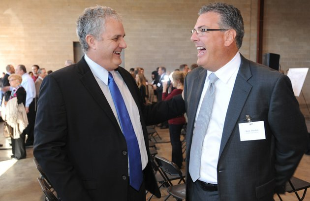 springdale-mayor-doug-sprouse-left-laughs-with-kent-hayden-ceo-of-south-coast-baking-wednesday-during-the-official-announcement-that-south-coast-a-bakery-company-based-in-california-is-establishing-a-facility-in-springdale