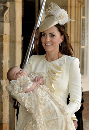 Kate, the Duchess of Cambridge, carries her son, Prince George, after his christening Wednesday at the Chapel Royal in St James's Palace in London.