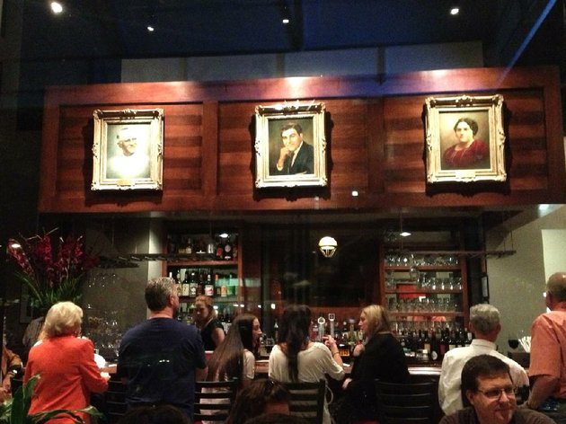 family-portraits-a-reminder-of-the-restaurants-history-hang-above-the-bustling-bar-at-brunos-little-italys-new-downtown-location