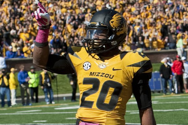 Missouri running back Henry Josey, left, celebrates after he scored on a 6-yard run in the third quarter of an NCAA college football game against Florida Saturday, Oct. 19, 2013, in Columbia, Mo. (AP Photo/L.G. Patterson)