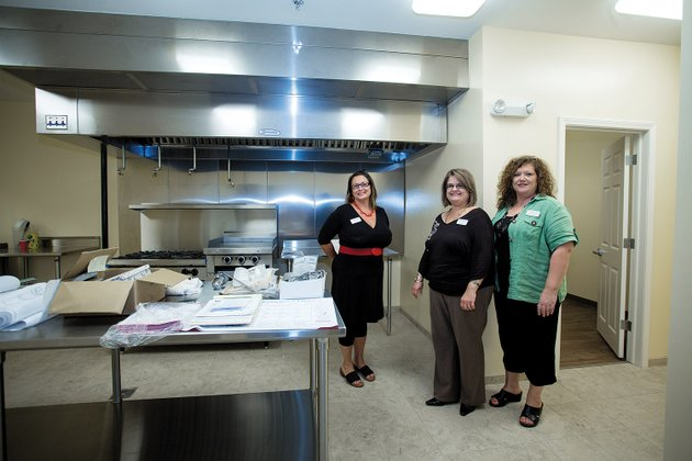 former-bethlehem-house-resident-and-board-member-beth-eakin-left-and-chairwoman-of-the-board-aimee-prince-and-board-member-marsha-mayfield-in-the-new-kitchen-area