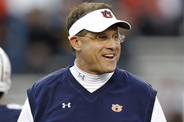 Auburn head coach Gus Malzahn walks around before the first half of an NCAA college football game against Florida Atlantic on Saturday, Oct. 26, 2013, in Auburn, Ala. (AP Photo/Butch Dill)