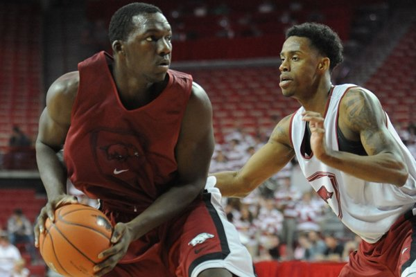 Arkansas forward Alandise Harris, left, looks to drive past guard Anthlon Bell during the second half of play in the Red-White game Sunday, Oct. 27, 2013, in Bud Walton Arena in Fayetteville.