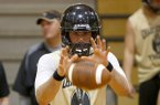 Charleston quarterback Ty Storey takes a snap during an Aug. 9, 2013 practice.
