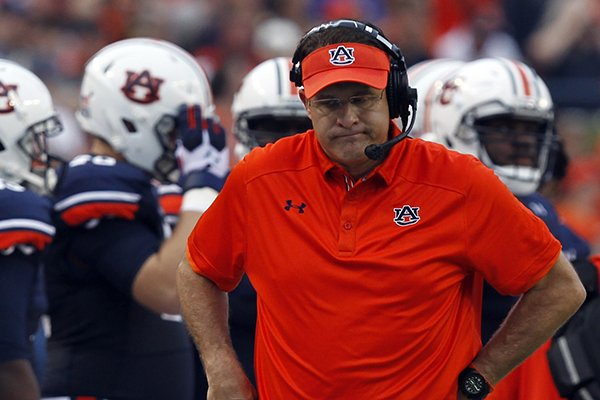 Auburn Tigers head coach Gus Malzahn shows some frustration after the first series during the first quarter of an NCAA college football game against Washington State on Saturday, Aug. 31, 2013, in Auburn, Ala. (AP Photo/Butch Dill)