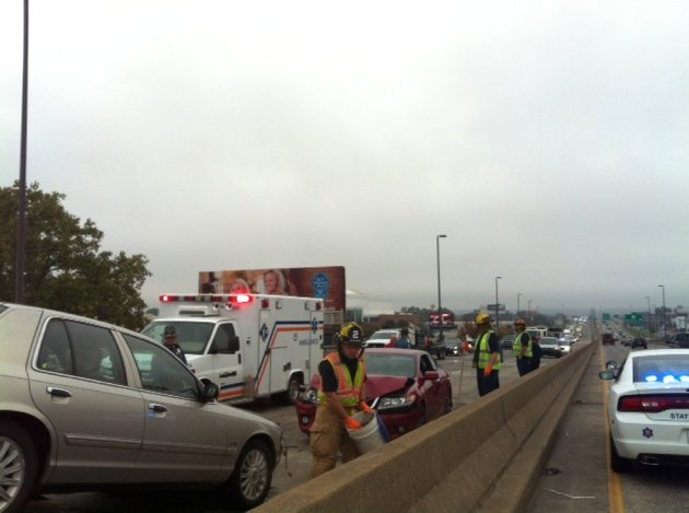 authorities-work-the-scene-monday-oct-28-2013-of-a-four-vehicle-wreck-on-the-interstate-30-bridge-between-little-rock-and-north-little-rock