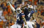 Auburn's Ryan Smith (24) and Quan Bray (4) celerate Smith's interception against Mississippi during the second half of an NCAA college football game on Saturday, Oct. 5, 2013 in Auburn, Ala. Auburn won 30-22. (AP Photo/Todd J. Van Emst)