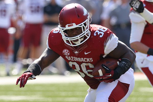 Arkansas fullback Kiero Small runs during an Oct. 12, 2013 game against South Carolina at Razorback Stadium in Fayetteville.
