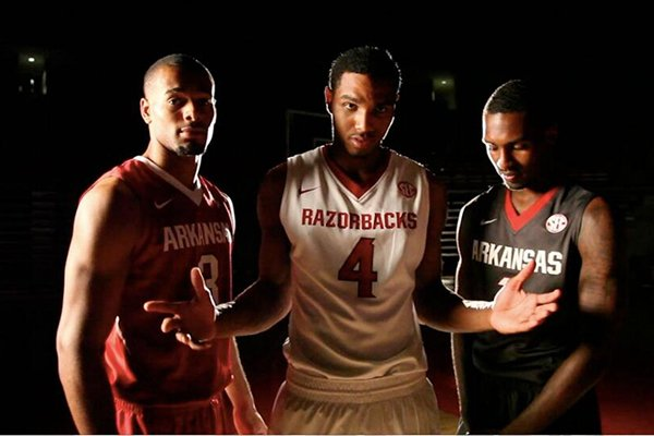 Arkansas players Rickey Scott, Coty Clarke and Mardracus Wade model the team's new basketball uniforms.