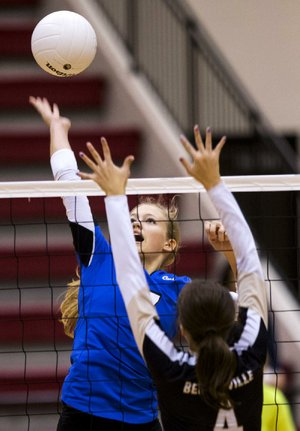 Bentonville's Sadie Pate (front) prepares to block a shot by Conway's Allison Weatherly during the Lady Tigers' 3-0 victory over the Lady Wampus Cats on Thursday at the Class 7A volleyball state tournament in Cabot.