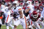 Auburn running back Tre Mason (21) carries past Arkansas linebacker Braylon Mitchell (34) during the first half of an NCAA college football game in Fayetteville, Ark., Saturday, Nov. 2, 2013. (AP Photo/Beth Hall)