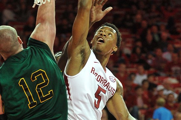 Arkansas guard Anthlon Bell goes for a lay-up during the second half of a Nov. 1, 2013 exhibition game against Missouri Southern at Bud Walton Arena.