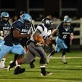 Josh Frazier, Springdale Har-Ber senior nose guard, chases down a Fayetteville running back during F...