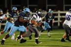 Josh Frazier, Springdale Har-Ber senior nose guard, chases down a Fayetteville running back during Friday at Jarrell Williams Bulldog Stadium in Springdale. Frazier's interception in overtime sealed the Wildcats' 34-31 win against the Bulldogs.
