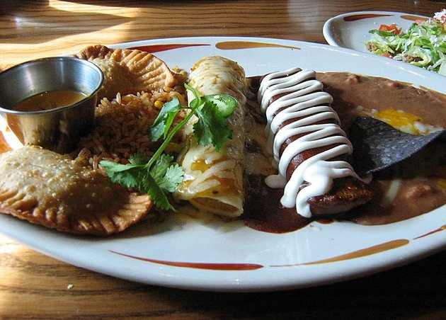 a-create-your-own-combo-plate-at-on-the-border-in-sherwood-includes-beef-empanadas-a-green-chile-chicken-enchilada-and-a-pork-tamale-plus-rice-and-beans
