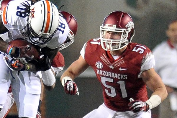 Arkansas linebacker Brooks Ellis pursues an offensive player during a Nov. 2, 2013 game against Auburn at Razorback Stadium in Fayetteville.